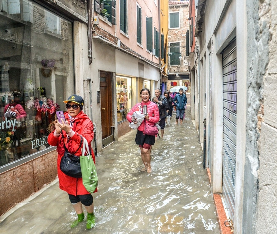 Holiday Makers Brave Venetian Floods by Glynn Rhodes